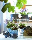 Table decoration with bluebells, water hyacinths & ceramic fish