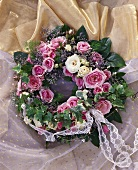 Festive wreath of roses, trailing ivy, asparagus fern etc.