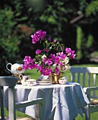 Table in garden with tea set and bougainvillea