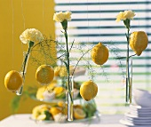 Decorative idea: lemons & yellow carnations hanging on wires