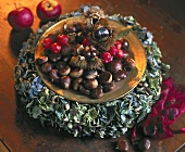 Plate of sweet chestnuts on a wreath of hydrangea flowers