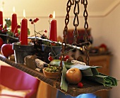 Autumn decoration: candles in terracotta pots hanging on chains