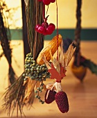 Hanging autumn decoration:  maize, tiny apples, raffia etc.
