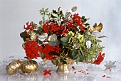 Arrangement of geraniums, holly, eucalyptus, honesty