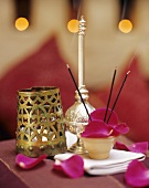 Table decoration with incense sticks