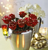 Gilded roses in a champagne bucket