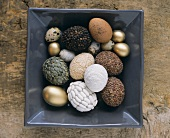 Various types of Easter eggs in a square bowl