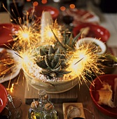 A laid table with burning sparklers