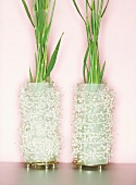 Two pearly vases of reeds