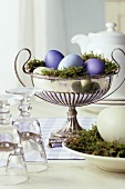 Coloured Easter eggs in a silver bowl