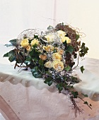 Heart-shaped bouquet of roses, trailing ivy and angel's hair