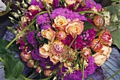 Small bouquet of Ageratum and roses from above
