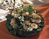 Flat arrangement of roses, Achillea, vine leaves & blackberries
