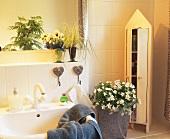 Bathroom decorated with plants - white campanula, sedge, violas
