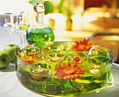 Glass bowl with floating Gerberas, floating candles & roses