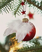 Red Christmas bauble decorated with angel's wings