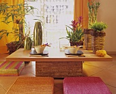 Oriental flair in dining room with bamboo and bromeliads
