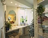 Green oasis in bathroom with cissus, mistletoe fig, umbrella papyrus etc.