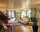 Scandinavian country house style living room enlivened with papyrus, bougainvillea and mimosa plants