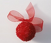 Red ball with bow