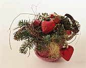 Arrangement of fir with Christmas decorations, hearts, parcels