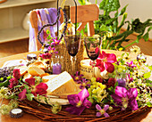 Cheese, wine, grapes, Clematis flowers and lavender