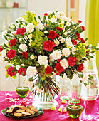 Arrangement of white and red carnations and Bells of Ireland