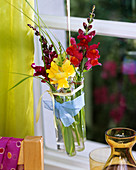 Hanging test tubes with yellow and red snapdragons
