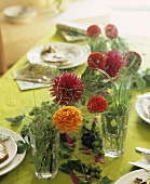 Table decoration of Zinnias, dill and hops