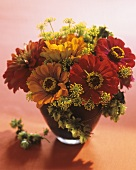 Arrangement of zinnias, dill and hops