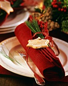 Red linen napkin with Christmas decoration