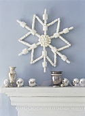 White star as wall decoration and silver balls on mantelpiece