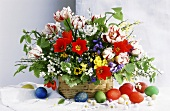 Easter bouquet with tulips in basket; Easter egg