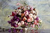 Summer bouquet of roses, sweet peas and convolvulus