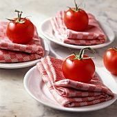 Italian table decoration with checked napkins and tomatoes