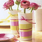 Springtime table decoration with pink flowers