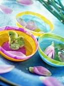Exotic flowers in bowls of water
