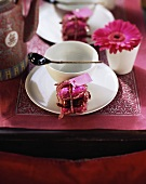 Asian place setting with white crockery and red decorations