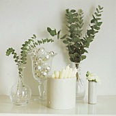 Greenery, white candles, flowers & silver balls on table