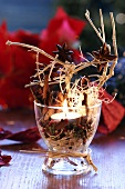 Christmas table decoration with spices and candle
