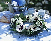Spring table decoration: wreath of pansies