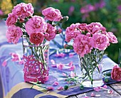 Small posies of pinks in glasses