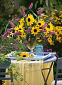 Vase of sunflowers and buddleia