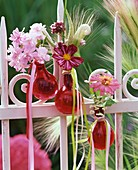 Floral decoration with cereal ears on garden fence