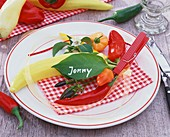 Rustic place-setting with peppers and place card (leaf)