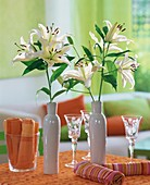 White lilies in ceramic bottles