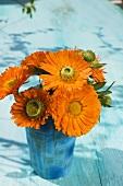 Marigolds in mother-of-pearl beaker