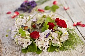 Wreath of hydrangeas, wild strawberries, roses, dill & lavender