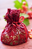 Small bag of soap to give as a gift, guelder rose berries