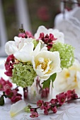 A bouquet of tulips, viburnums and japonica